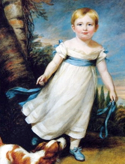 3 year old in white muslin with blue sash and shoes