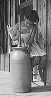 young girl butter churn