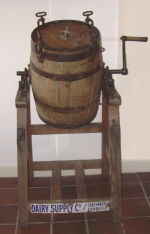 Churn with handle, frame, enamel maker's label