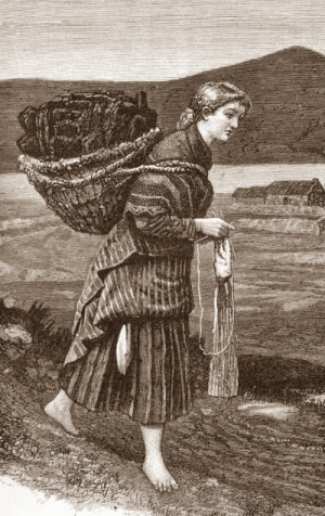 Barefoot young woman knitting while carrying heavy basket on back