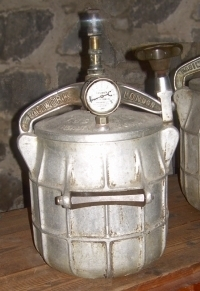 barrel-shaped canister with dial